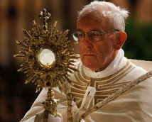 Pope Francis carries monstrance during observance of Corpus Christi feast